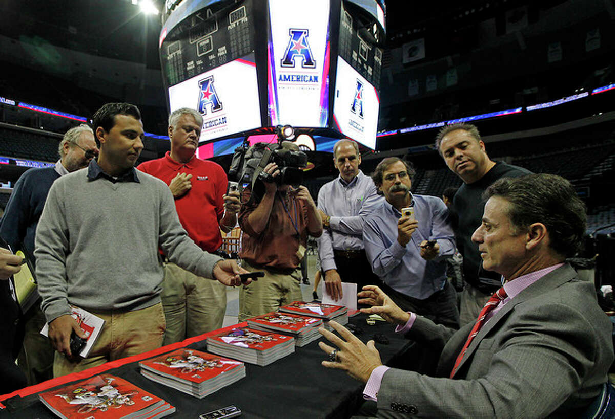 Louisville head basketball coach Rick Pitino answers questions at the American Athletic Conference NCAA college basketball media day on Wednesday, Oct. 16, 2013 in Memphis, Tenn. (AP Photo/Lance Murphey)