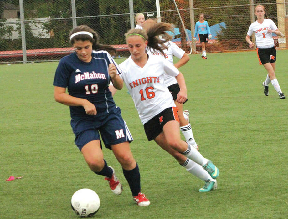 Photo by Joe RyanBrien McMahon's Kayla Shaak dribbles the ball as Erica Stietzel of Stamford pursues during Wednesday's game in Stamford. The Black Knights defeated the Senators, 1-0.