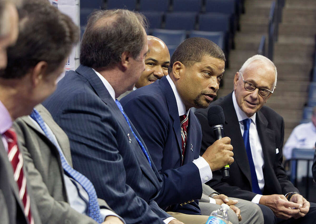 Rutgers coach Eddie Jordan, center, answers questions atthe American Athletic Conference NCAA college basketball media day on Wednesday, Oct. 16, 2013, in Memphis, Tenn. (AP Photo/Lance Murphey)