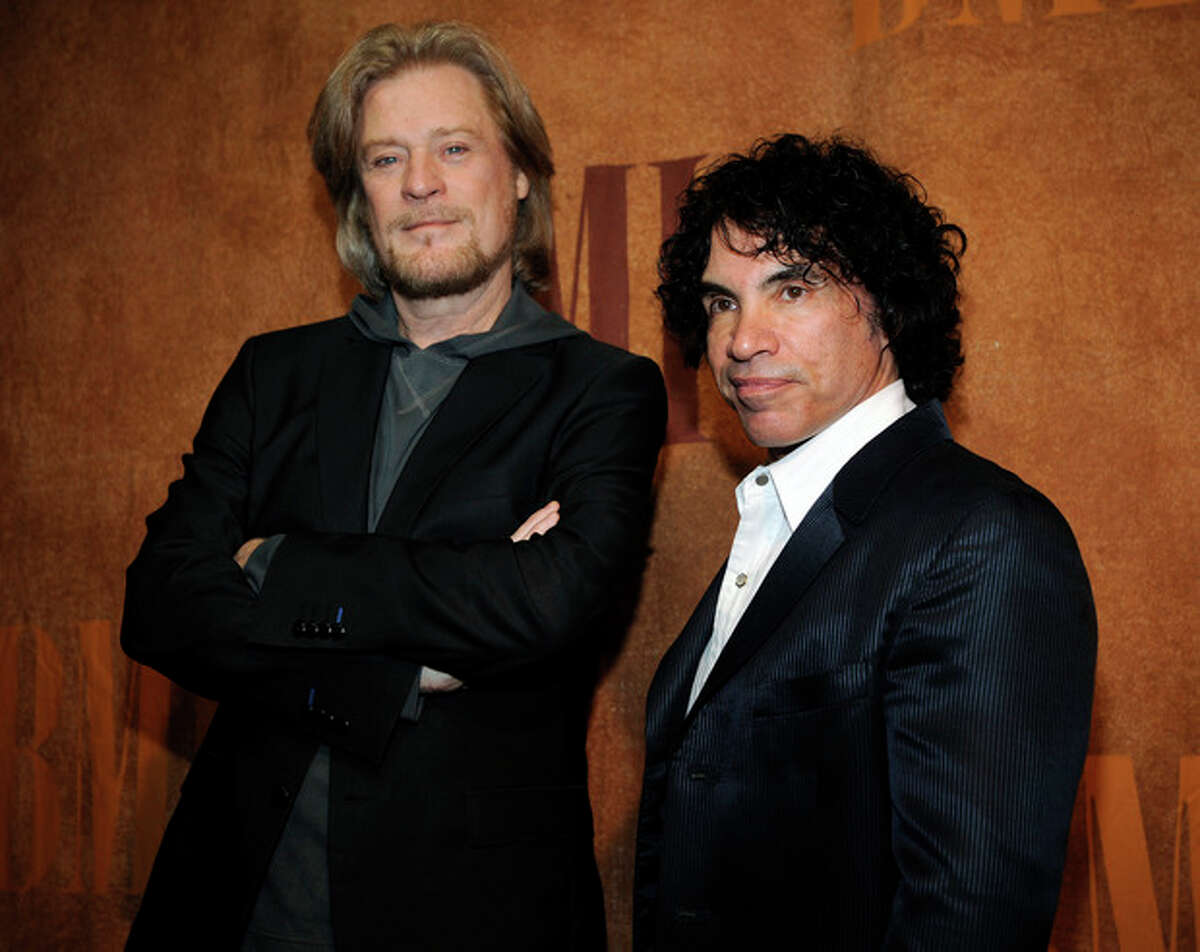 FILE - In this May 20, 2008 file photo, Daryl Hall, left, and John Oates pose together before the 56th annual BMI Pop Awards in Beverly Hills, Calif. Nirvana, Linda Ronstadt, Peter Gabriel, Hall and Oates, and The Replacements are among first-time nominees to the Rock and Roll Hall of Fame. The hall of fame announced its annual list of nominees Wednesday morning, Oct. 16, 2013, and half the field of 16 were first-time nominees. (AP Photo/Chris Pizzello, file)
