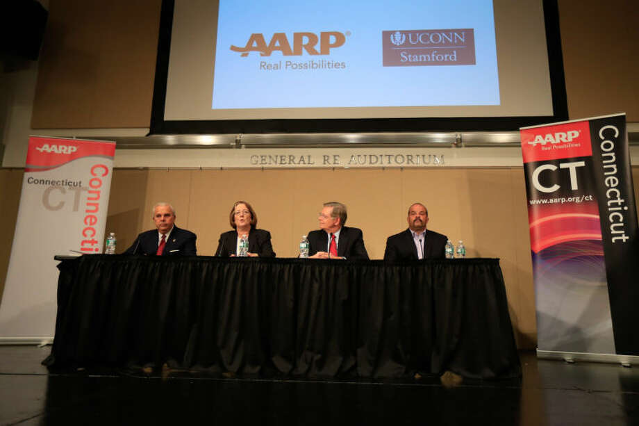 From left, Michael Fedele, Kathleen Murphy, David Martin, and John Zito speak at the AARP sponsored intergenerational Stamford Mayoral Candidate Forum at UCONN Stamford Thursday night.