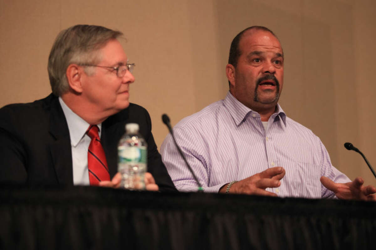 Stamford mayoral candidate John Zito (right) speaks next to his opponent David Martin at the AARP sponsored intergenerational Stamford Mayoral Candidate Forum at UCONN Stamford Thursday night.