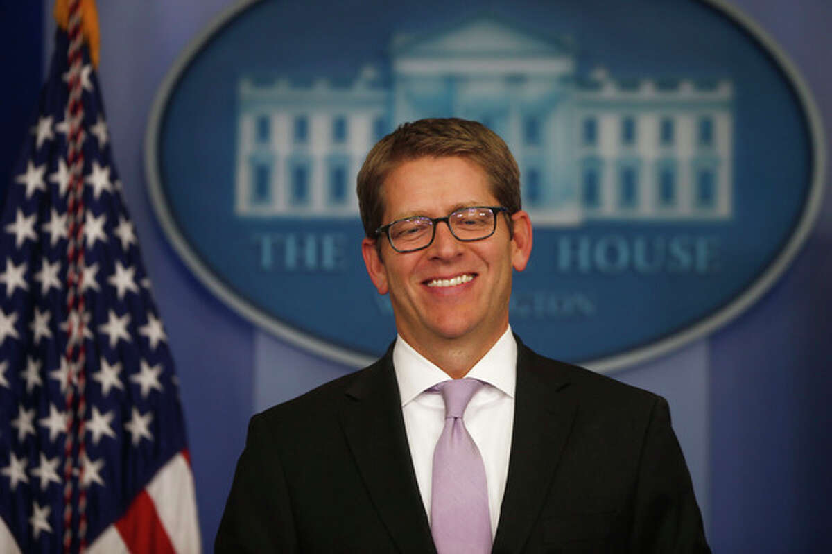 White House Press Secretary Jay Carney smiles as he arrives for the daily press briefing President Barack Obama makes a statement at the White House in Washington, Wednesday, Oct. 16, 2013, after lawmakers reached a bipartisan deal to avoid default and reopen the government. (AP Photo/Charles Dharapak)