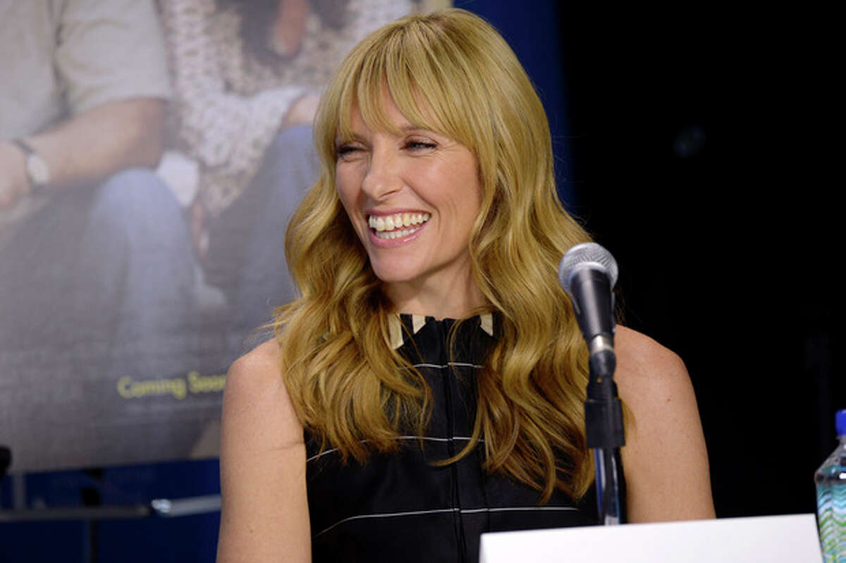 """FILE - In this Sept. 8, 2013 file photo, Toni Collette attends the news conference for """"Enough Said"""" on day 4 of the Toronto International Film Festival in Toronto. A play about four people who share the same last name is coming to Broadway with some awfully big names attached. Collette, Michael C. Hall, Marisa Tomei and Tracy Letts are set to star in Will Eno?'s play ?""""The Realistic Joneses?"""" early next year. Previews are set to begin in February and an opening scheduled at a theater to be announced later for late March. (Photo by Evan Agostini/Invision/AP)"""