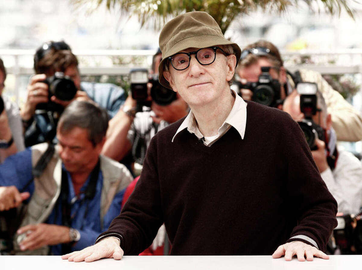 """FILE - In this May 15, 2010 file photo, filmmaker Woody Allen poses during a photo call for the film """"You Will Meet a Tall Dark Stranger,"""" at the 63rd international film festival, in Cannes, southern France. Allen is busy preparing his latest movie, ?""""Magic in the Moonlight.?"""" Continuing his European intrigue, Allen?'s upcoming film, which is set in southern France and has already begun production, and stars Colin Firth, Emma Stone, Eileen Atkins, Marcia Gay Harden, Hamish Linklater, Simon McBurney, and Jacki Weaver. (AP Photo/Matt Sayles, file)"""