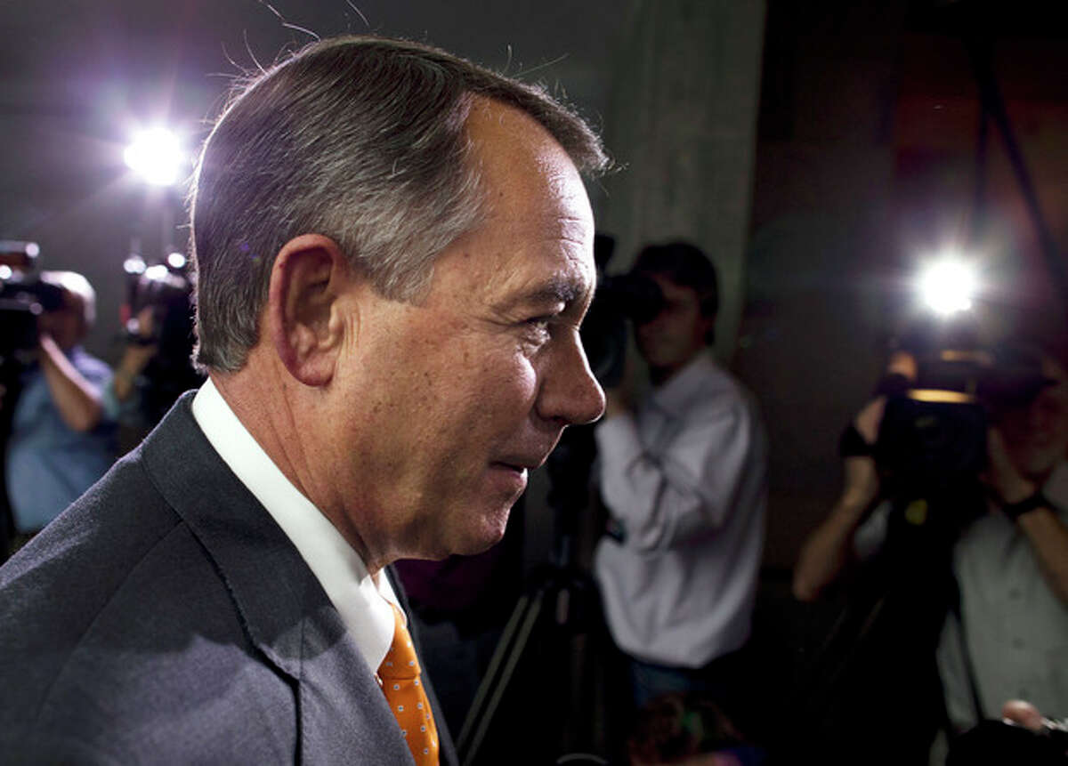 Speaker of the House Rep. John Boehner, R-Ohio, walks past reporters after a meeting with House Republicans on Capitol Hill on Wednesday, Oct. 16, 2013 in Washington. The partial government shutdown is in its third week and less than two days before the Treasury Department says it will be unable to borrow and will rely on a cash cushion to pay the country's bills. (AP Photo/ Evan Vucci)