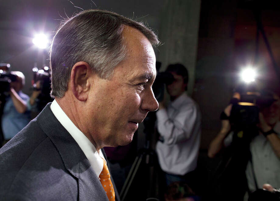 Speaker of the House Rep. John Boehner, R-Ohio, walks past reporters after a meeting with House Republicans on Capitol Hill on Wednesday, Oct. 16, 2013 in Washington. The partial government shutdown is in its third week and less than two days before the Treasury Department says it will be unable to borrow and will rely on a cash cushion to pay the country's bills. (AP Photo/ Evan Vucci) / AP