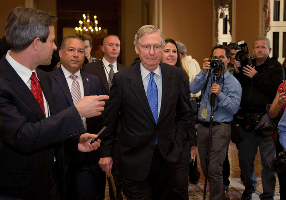 Senate Minority Leader Sen. Mitch McConnell, R-Ky., walks to the Senate floor after agreeing to the framework of a deal to avoid default and reopen the government on Capitol Hill on Wednesday, Oct. 16, 2013 in Washington. The partial government shutdown is in its third week and less than two days before the Treasury Department says it will be unable to borrow and will rely on a cash cushion to pay the country's bills. (AP Photo/ Carolyn Kaster) / AP