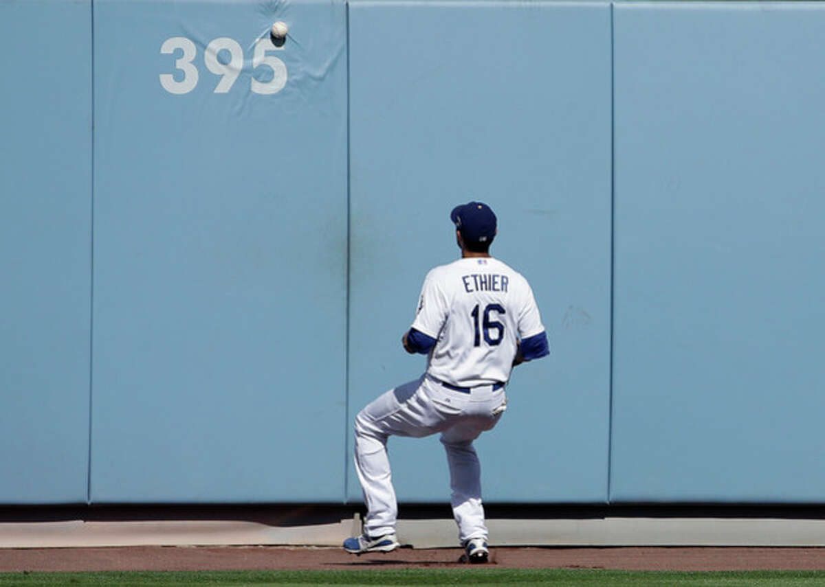 Los Angeles Dodgers' Andre Ethier watches a triple off the wall by St. Louis Cardinals' Carlos Beltran during the third inning of Game 5 of the National League baseball championship series, Wednesday, Oct. 16, 2013, in Los Angeles. (AP Photo/David J. Phillip)