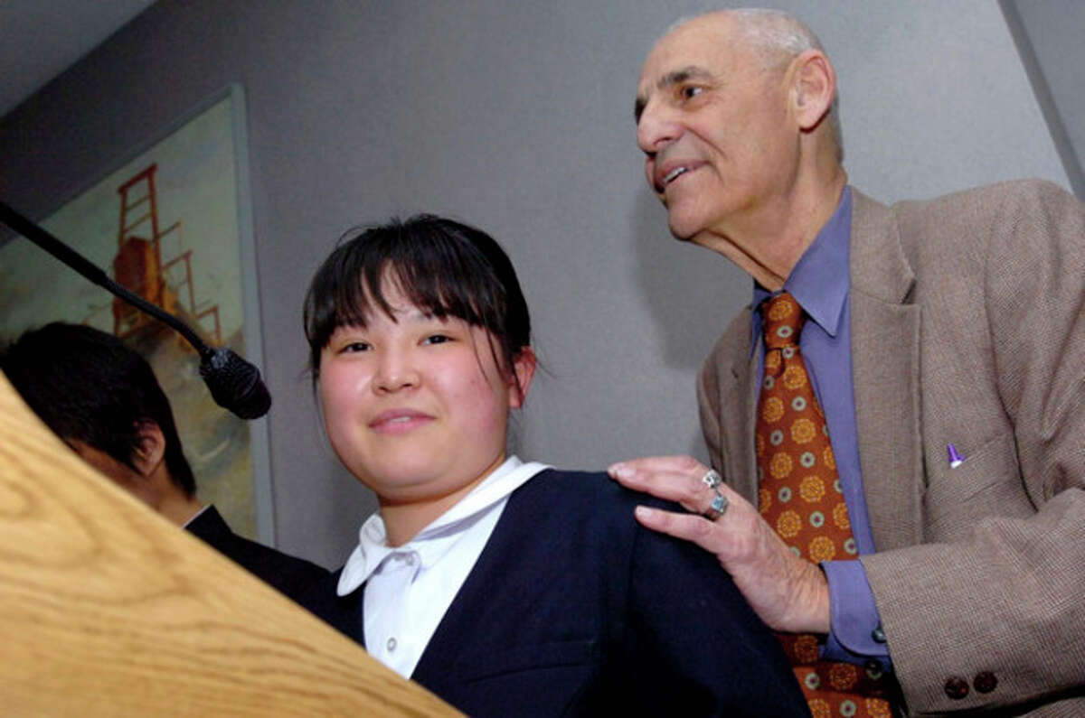 Hour file photo / Matthew Vinci Dr. William Jassey, consultant to the Board of Education's Japanese exchange program in Norwalk introduces Kotone Veki 15, who spoke to families and teachers on Tuesday night at City Hall