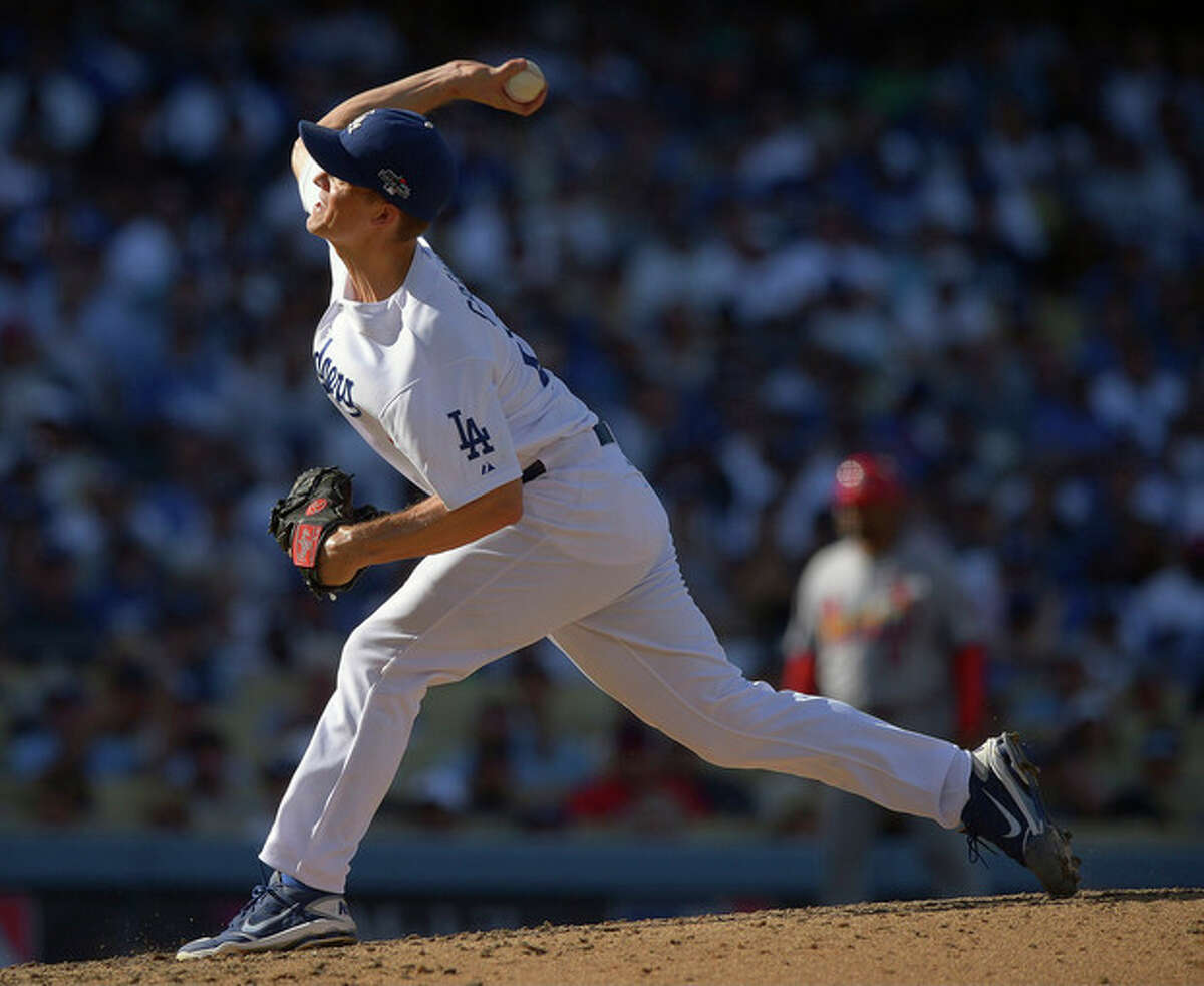 Los Angeles Dodgers starting pitcher Zack Greinke throws during the seventh inning of Game 5 of the National League baseball championship series against the St. Louis Cardinals Wednesday, Oct. 16, 2013, in Los Angeles. (AP Photo/Mark J. Terrill)