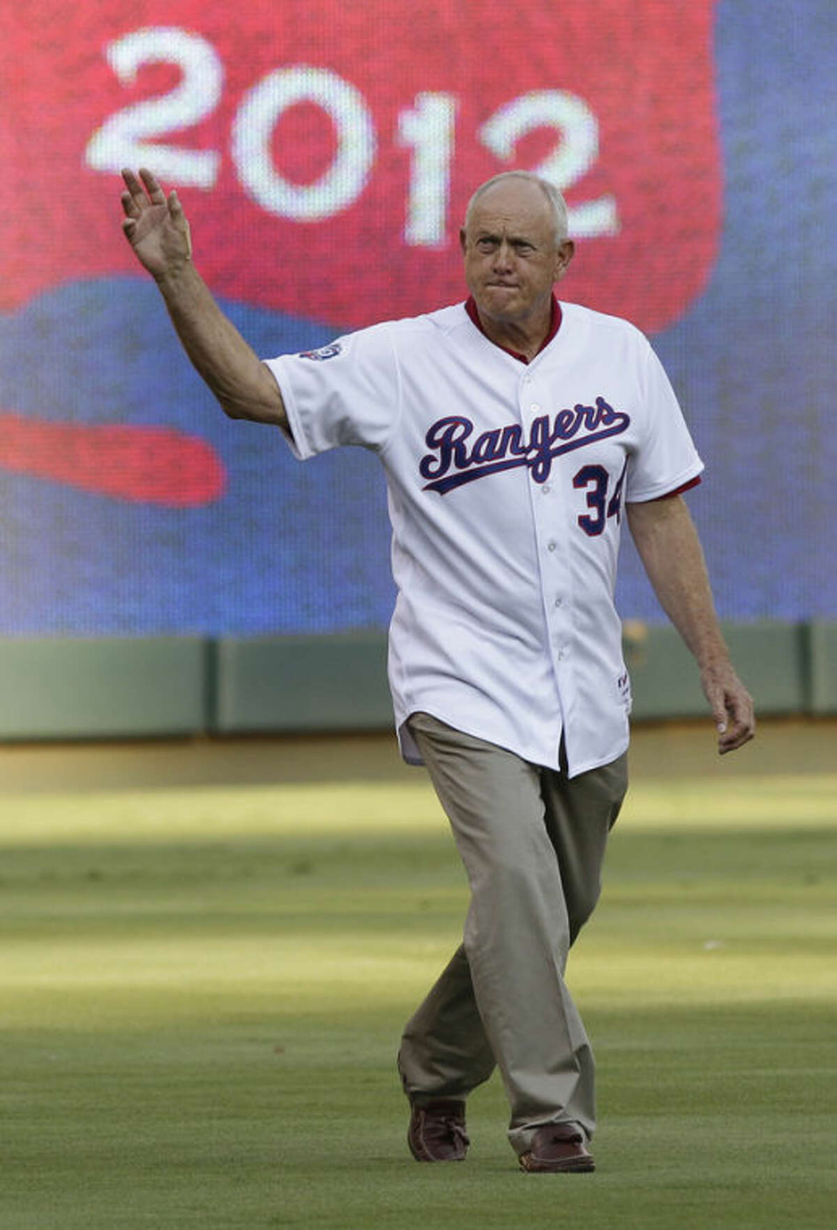 FILE - In this Aug. 11, 2012, file photo, Texas Rangers CEO Nolan Ryan waves to fans before a baseball game in Arlington, Texas. Ryan announced in a statement on Thursday, Oct. 17, 2013, that he hs retiring after six years of serving as CEO of the Rangers. The Hall of Fame pitcher became the 10th president of the Rangers in February 2008 and became chief executive officer three years later. (AP Photo/LM Otero, File)