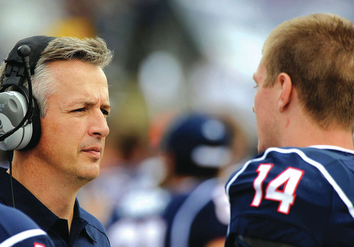AP photo UConn interim head coach T.J. Weist, left, talks to quarterback Tim Boyle (14) during the Huskies' 13-10 loss to South Florida on Oct. 12. A former assistant at Cincinnati, Weist leads the Huskies into Nippert Stadium Saturday to face the Bearcats.
