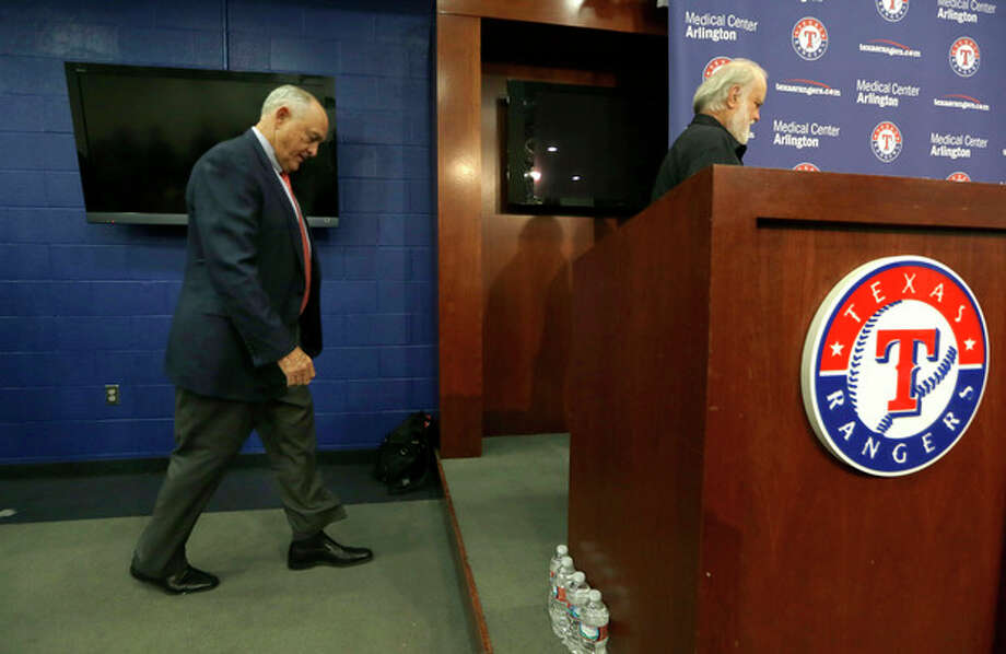 Texas Rangers CEO and President Nolan Ryan, left, follows team owner Bob Simpson to the desk for a news conference to announce Ryan's retirement from the Rangers in Arlington, Texas, Thursday, Oct. 17, 2013. Ryan is retiring after six seasons as CEO and will retire at the end of this month. (AP Photo/LM Otero) / AP