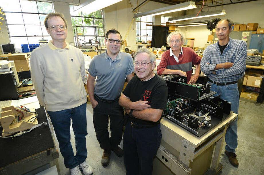 Hour Photo/Alex von Kleydorff . L-R Derek Hodgeman, Eric Anderson, Jack Cohen, Bob Anderson and John Vaughan, part of the Buck Scientific team.