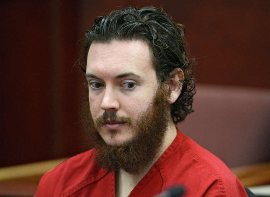 FILE -This June 4, 2013 file photo shows Aurora theater shooting suspect James Holmes in court in Centennial, Colo. On Tuesday, Oct. 15, 2013, Holmes' lawyers will argue that the two hours that passed before he was read his Miranda rights violated his constitutional rights and that anything he told the arresting officers should be barred from his trial. (AP Photo/The Denver Post, Andy Cross, Pool, File) / Pool Denver Post