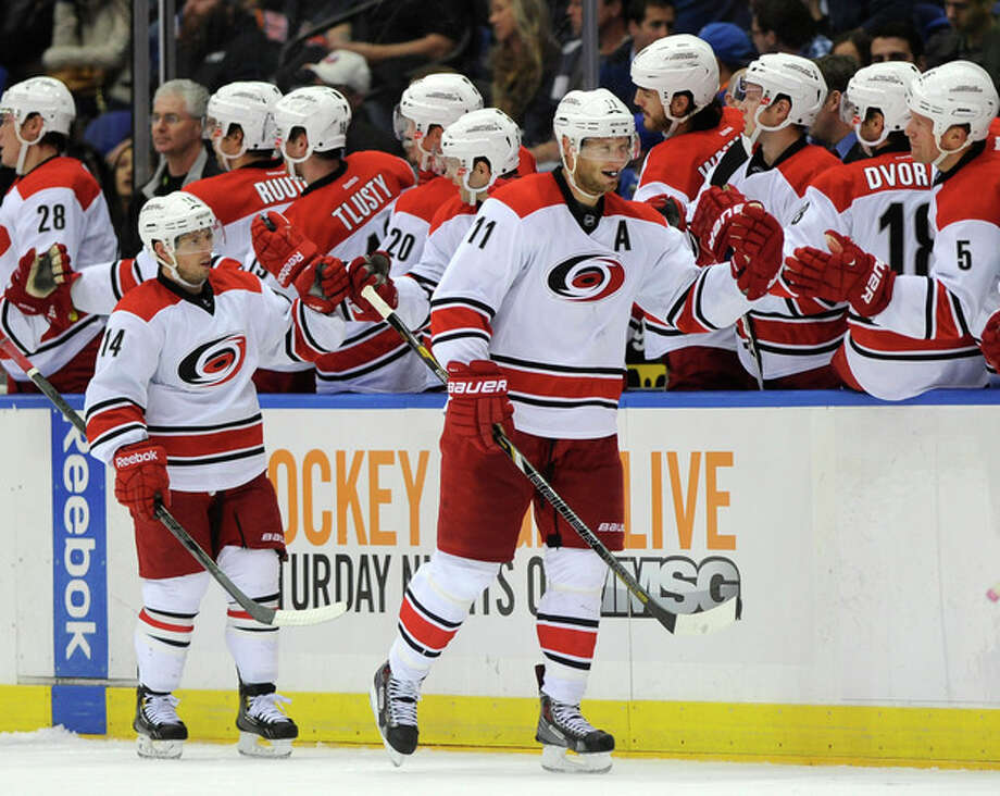 Carolina Hurricanes' Jordan Staal (11) and Nathan Gerbe (14) celebrate Staal's goal against the New York Islanders with teammates in the second period of an NHL hockey game Saturday, Oct. 19, 2013, in Uniondale, N.Y. (AP Photo/Kathy Kmonicek) / FR170189 AP