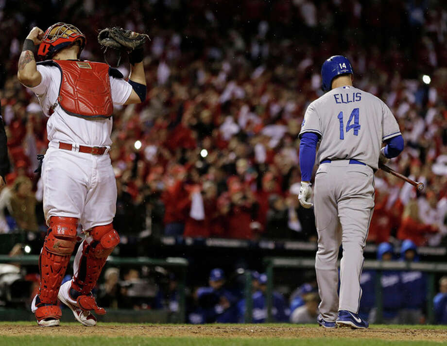 St. Louis Cardinals catcher Yadier Molina reacts after Los Angeles Dodgers' Mark Ellis strikes out to end Game 6 of the National League baseball championship series Friday, Oct. 18, 2013, in St. Louis. The Cardinals won 9-0 to win the series. (AP Photo/Jeff Roberson) / AP