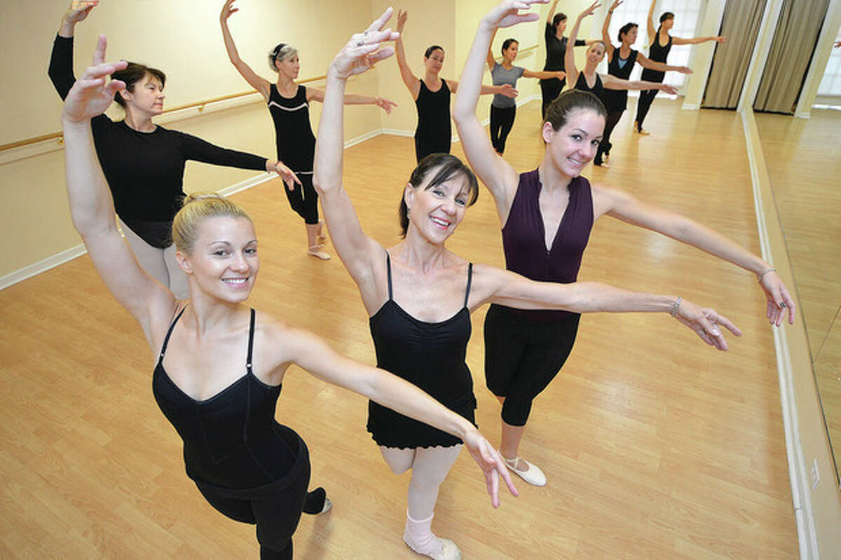 Hour photo / Alex von Kleydorff Heidi Freyer, Linda Freyer and Petra Freyer practice during one of their morning ballet classes at the Freyer Academy of Ballet in Wilton.