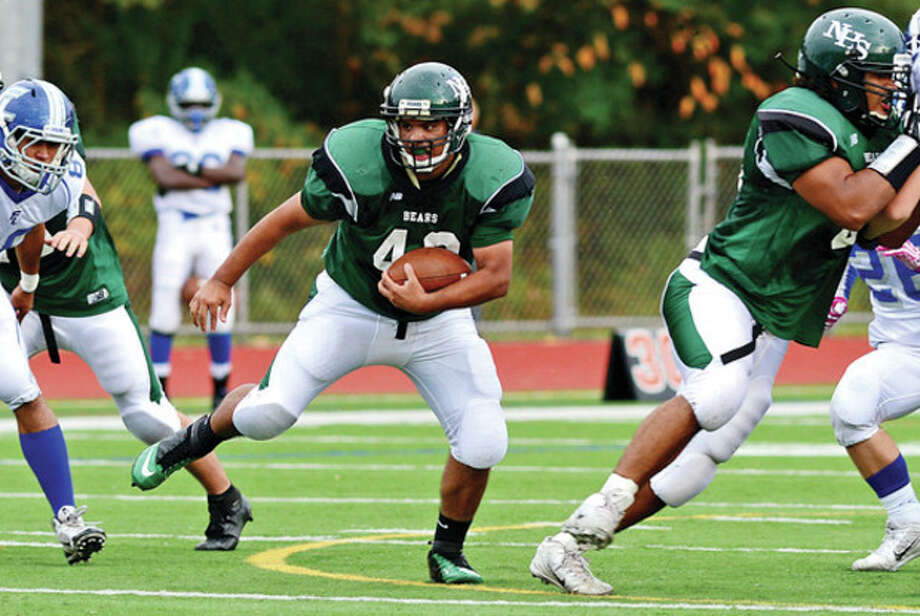 Hour photo/Erik TrautmannNorwalk's Ricky Mejia looks for running room during Saturday's game against Fairfield Ludlowe at Testa Field. Ludlowe won, 13-6. / (C)2013, The Hour Newspapers, all rights reserved