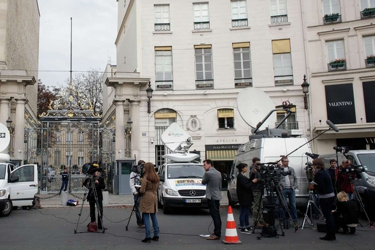Media wait outside Interior Ministry, as France's President delivers a speech at the Elysee Palace nearby, in Paris, Saturday, Oct. 19, 2013. Hollande says a 15-year-old girl who was detained as she got off a bus from a school trip and expelled with her family can return to France to continue her studies. But the rest of the family cannot come with her. (AP Photo/Thibault Camus)