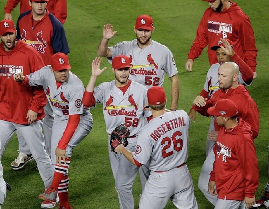 St. Louis Cardinals relief pitcher Trevor Rosenthal (26) is congratulated by teammates after Game 4 of the National League baseball championship series against the Los Angeles Dodgers Tuesday, Oct. 15, 2013, in Los Angeles. The Cardinals won 4-2 to take a 3-1 lead in the series. (AP Photo/Jae C. Hong) / AP