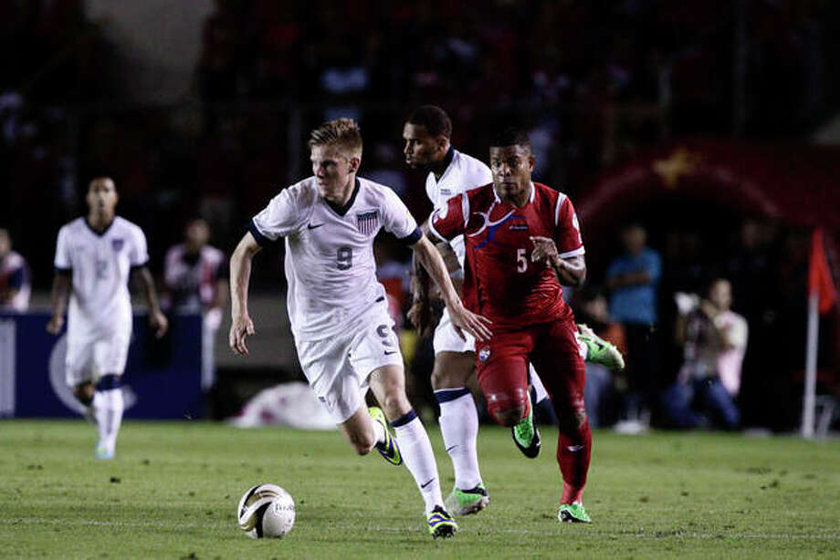 Aron Johannsson drives the ball as Panama's Roman Torres follows during a 2014 World Cup qualifying soccer match in Panama City, Tuesday, Oct. 15, 2013. (AP Photo/Arnulfo Franco) / AP