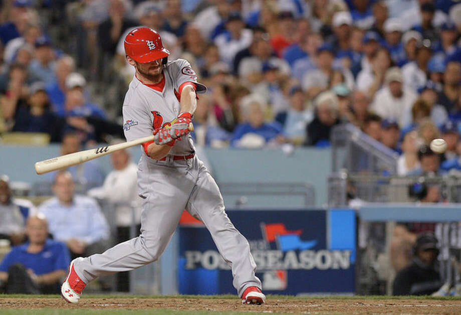 St. Louis Cardinals' Shane Robinson hits a home run during the seventh inning of Game 4 of the National League baseball championship series against the Los Angeles Dodgers, Tuesday, Oct. 15, 2013, in Los Angeles. (AP Photo/Mark J. Terrill) / AP