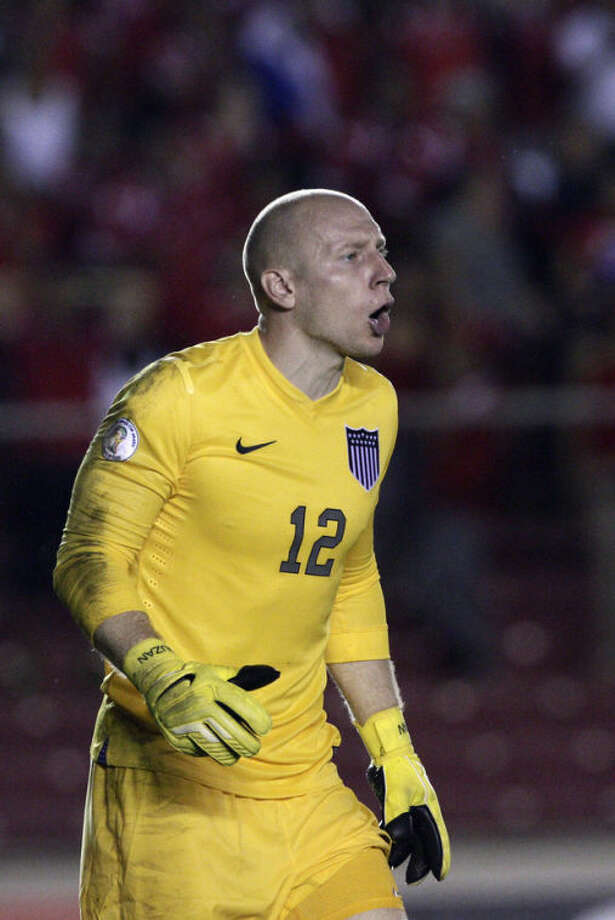 U.S. goalkeeper Brad Guzman shouts during a 2014 World Cup qualifying soccer match against Panama, in Panama City, Tuesday, Oct. 15, 2013. (AP Photo/Arnulfo Franco)
