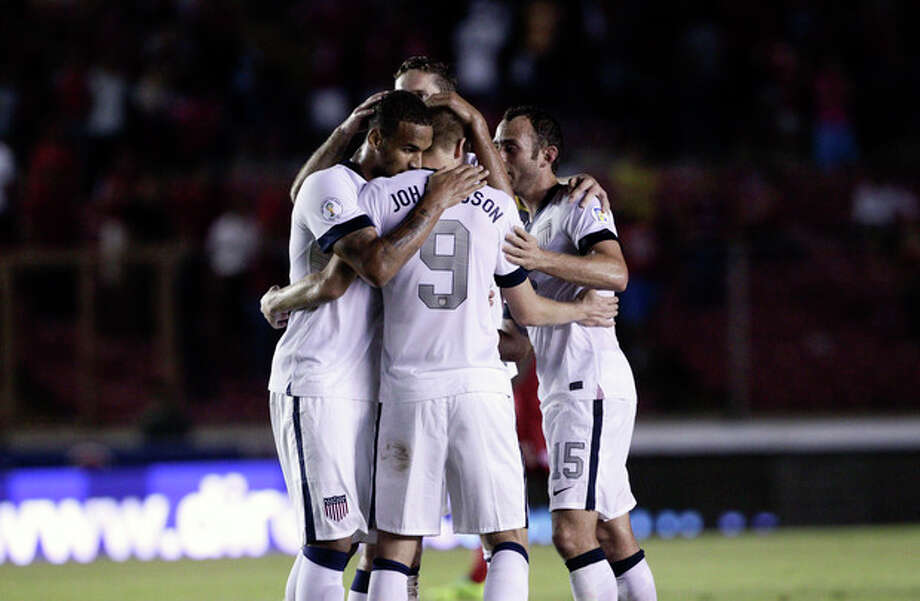 Aron Johannsson, center, of the U.S. celebrates with teammates after scoring a goal against Panama in a 2014 World Cup qualifying soccer match, in Panama City, Tuesday, Oct. 15, 2013. The United States rallied for a 3-2 win at Panama on Tuesday night that left Mexico's World Cup hopes alive and knocked out the Panamanians. (AP Photo/Arnulfo Franco) / AP