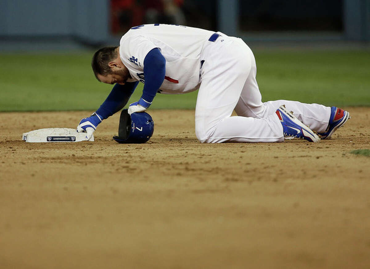 Los Angeles Dodgers' Nick Punto prepares to get up after being picked off second during the seventh inning of Game 4 of the National League baseball championship series against the St. Louis Cardinals, Tuesday, Oct. 15, 2013, in Los Angeles. (AP Photo/David J. Phillip)