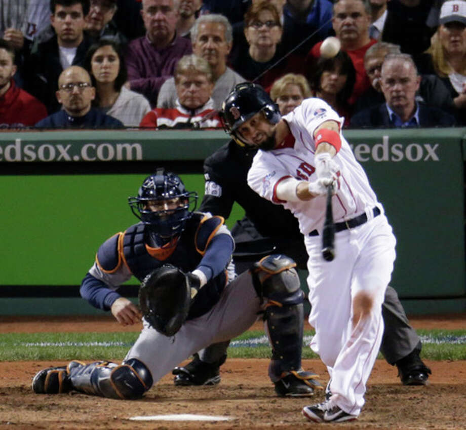 Boston Red Sox's Shane Victorino hits a grand slam against the Detroit Tigers in the seventh inning during Game 6 of the American League baseball championship series on Saturday, Oct. 19, 2013, in Boston. (AP Photo/Charlie Riedel) / AP