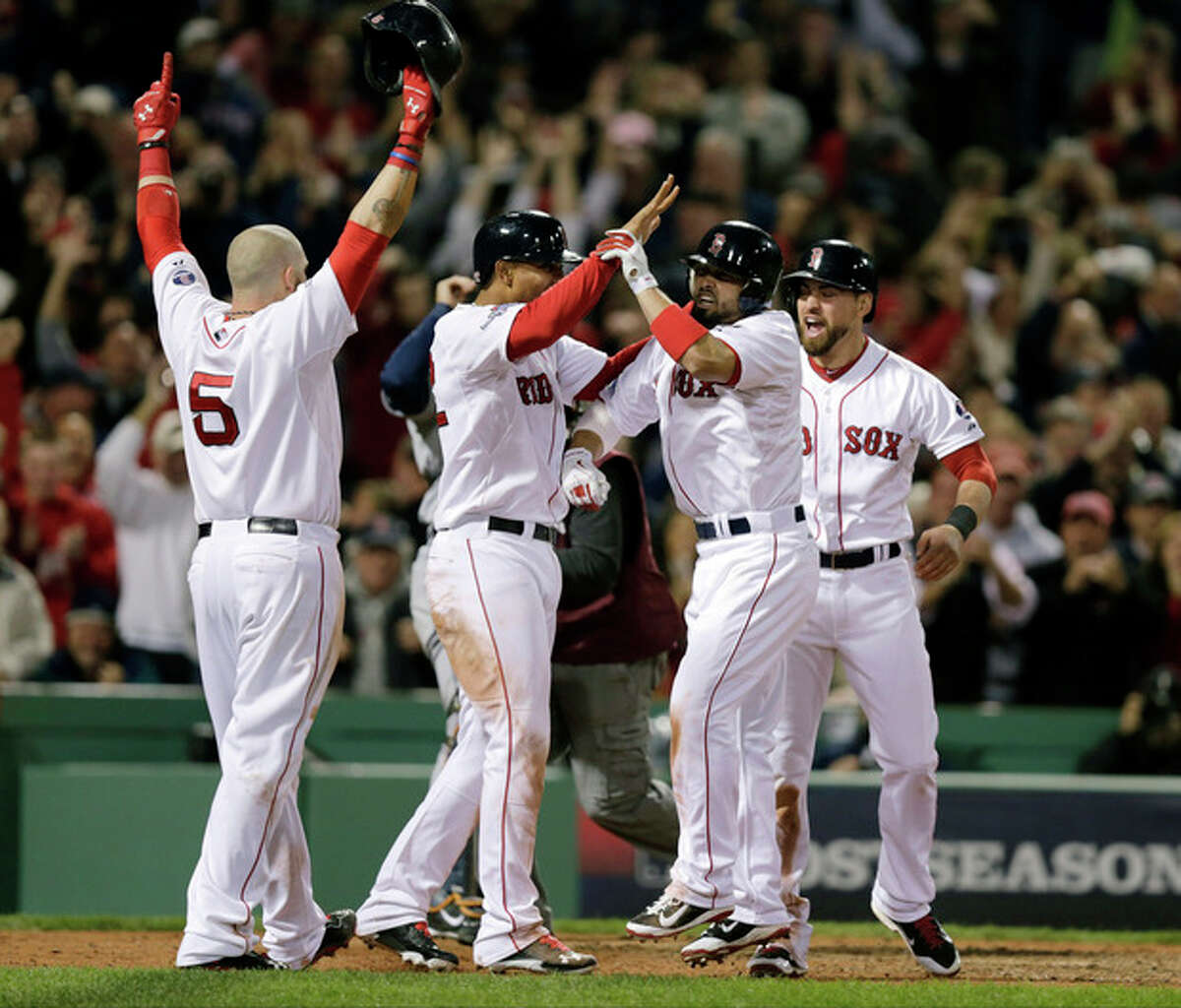 Boston Red Sox's Shane Victorino, second from right, celebrates his grand slam with Jonny Gomes, left, Xander Bogaerts, second from left, and Jacoby Ellsbury, right, in the seventh inning during Game 6 of the American League baseball championship series against the Detroit Tigers on Saturday, Oct. 19, 2013, in Boston. (AP Photo/Charlie Riedel)