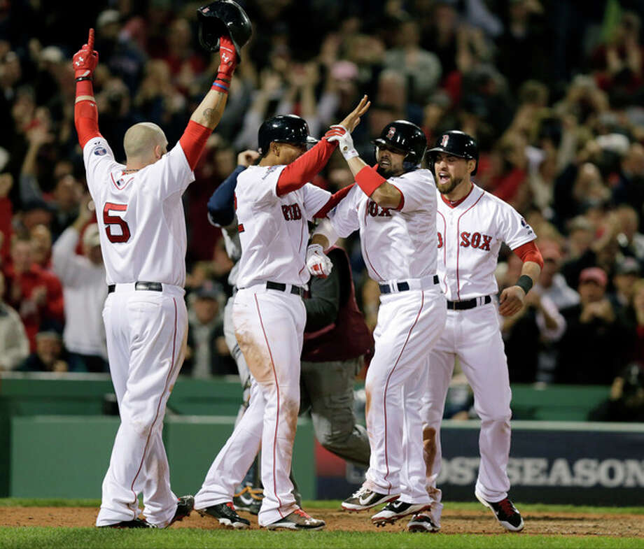 Boston Red Sox's Shane Victorino, second from right, celebrates his grand slam with Jonny Gomes, left, Xander Bogaerts, second from left, and Jacoby Ellsbury, right, in the seventh inning during Game 6 of the American League baseball championship series against the Detroit Tigers on Saturday, Oct. 19, 2013, in Boston. (AP Photo/Charlie Riedel) / AP