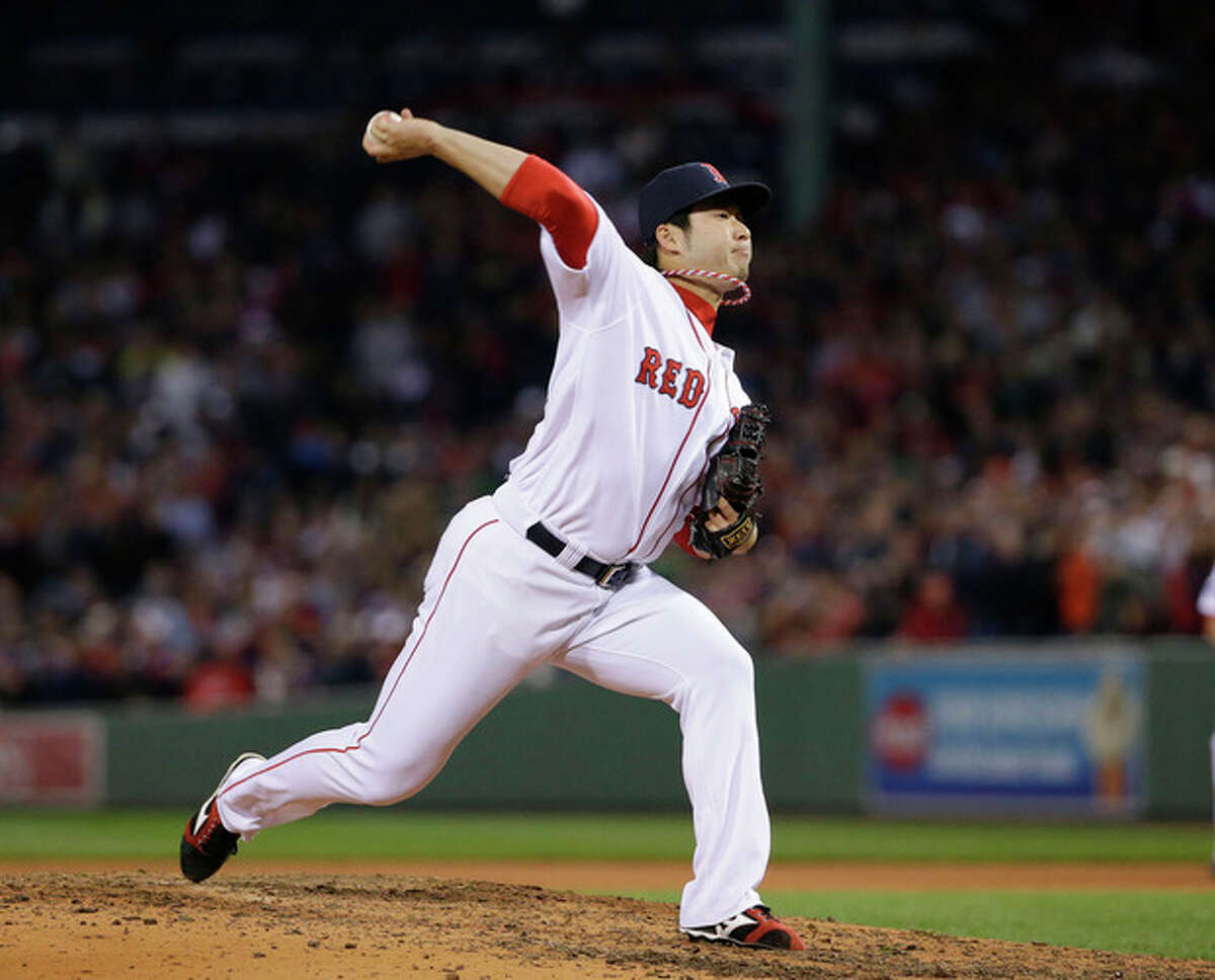 Boston Red Sox relief pitcher Junichi Tazawa throws against the Detroit Tigers in the seventh inning during Game 6 of the American League baseball championship series on Saturday, Oct. 19, 2013, in Boston. (AP Photo/Matt Slocum)