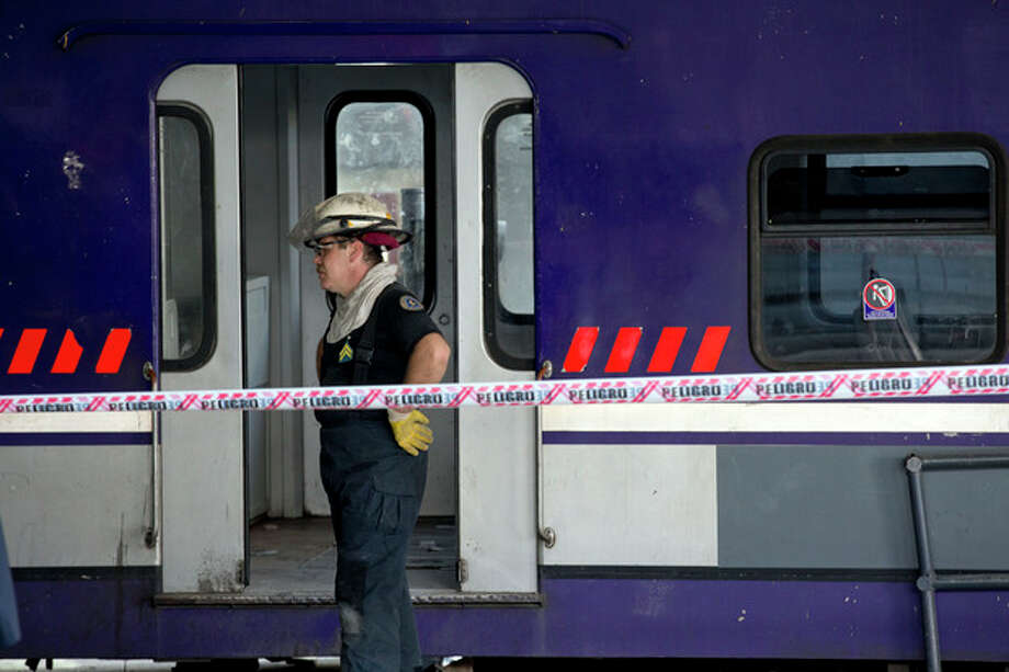 A fireman stands beside a commuter train that slammed into the end of the line when arriving to Once central station in Buenos Aires, Argentina, Saturday, Oct. 19, 2013. Emergency officials aren't reporting any deaths, but they say at least 35 people are injured, five seriously. Security Secretary Sergio Berni says they are still evacuating the wrecked train and have found no fatalities. (AP Photo/Natacha Pisarenko) / AP