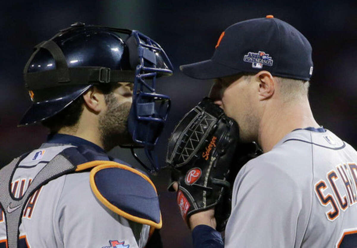 Detroit Tigers catcher Alex Avila, left, talks to starting pitcher Max Scherzer in the seventh inning during Game 6 of the American League baseball championship series against the Boston Red Sox on Saturday, Oct. 19, 2013, in Boston. (AP Photo/Matt Slocum)
