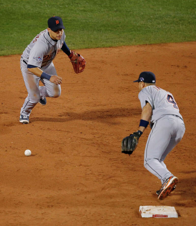 Detroit Tigers shortstop Jose Iglesias, left, can't make a play on a ball hit by Boston Red Sox's Jacoby Ellsbury in the seventh inning during Game 6 of the American League baseball championship series on Saturday, Oct. 19, 2013, in Boston. At right is Tigers second baseman Omar Infante. (AP Photo/Elise Amendola) / AP