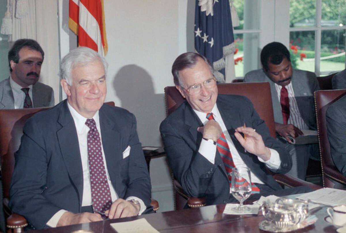 FILe - In this June 6, 1989 file photo, House Speaker Tom Foley of Washington sits next to U.S. President George H. Bush during a meeting with the congressional leadership at the White House in Washington. Foley has died at the age of 84, according to House Democratic aides on Friday, Oct. 18, 2013, who spoke on condition of anonymity. Foley was a Washington state lawmaker who became the first speaker since the Civil War who failed to win re-election in his home district. He was U.S. ambassador to Japan for four years during the Clinton administration. But he spent the most time in the House, serving 30 years including more than five as speaker.(AP Photo/Rick Bowmer, file)