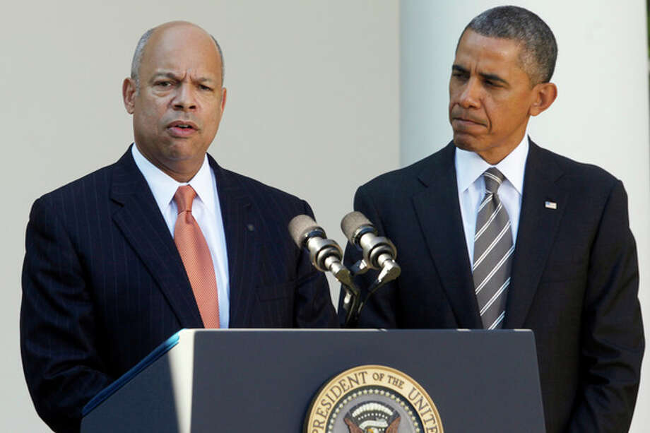 President Barack Obama stands with Jeh Johnson, his choice for the next Homeland Security Secretary, in the Rose Garden at the White House in Washington, Friday, Oct. 18, 2013. Johnson was general counsel at the Defense Department during the wars in Iraq and Afghanistan. (AP Photo/Charles Dharapak) / AP