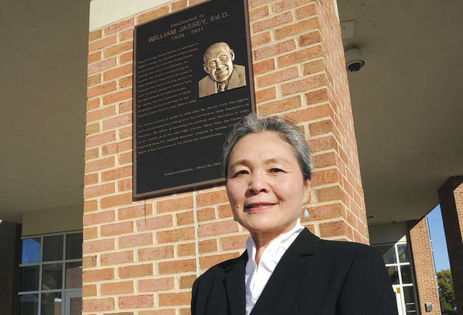 Hour photos / Matthew VinciAbove, Dr. Ikuko Jassey, wife of honoree Dr. William Jassey, attends a dedication ceremony Sunday at the Brien McMahon High School Center for Global Studies. Below, Lisa Salzman, daughter of Dr. William Jassey, is one of many speakers at the dedication ceremony.