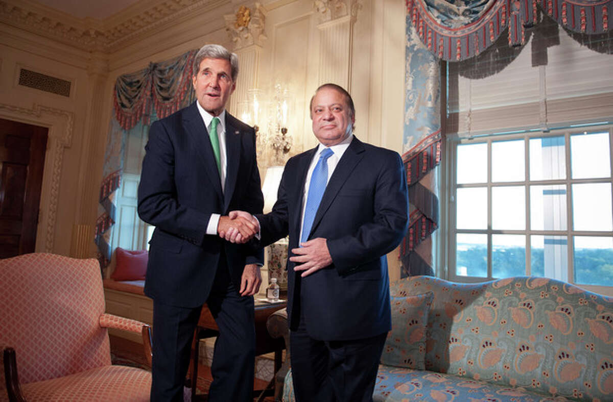 Secretary of State John Kerry shake hands with Pakistan Prime Minister Nawaz Sharif prior to their meeting at the State Department in Washington, Sunday, Oct. 20, 2013. (AP Photo/Cliff Owen)