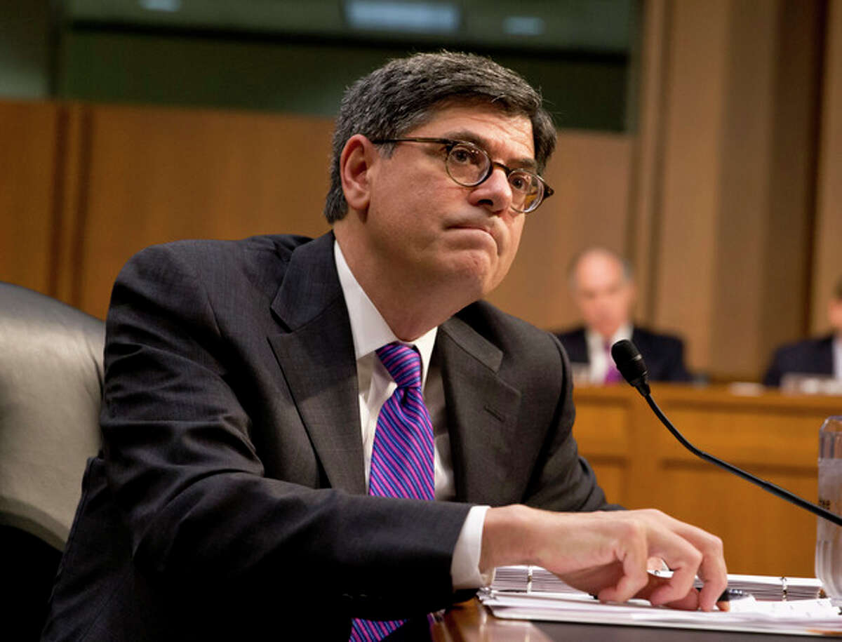 """RETRANSMISSION TO ADD AND CLARIFY WHERE AND WHEN LEW COMMENTED ON BUDGET BATTLE - FILE - In this Oct. 10, 2013 file photo Treasury Secretary Jacob Lew testifies before the Senate Finance Committee on Capitol Hill in Washington to urge Congress to reopen the government and lift the US borrowing cap. Lew said on NBC's """"Meet the Press"""" Sunday, Oct. 20, 2013, during a pre-taped interview that the fight over government spending pushed the country near the brink of default and the lesson has to be that it can't happen again. Lew says this latest battle was scarier than the 2011 budget fight because it got """"so close to the edge."""" (AP Photo/J. Scott Applewhite)"""