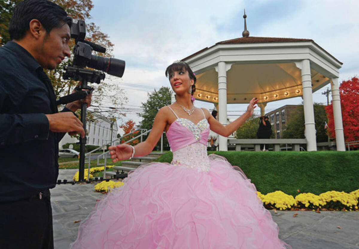 Hour photo / Erik Trautmann The new gazebo on the Norwalk Town Green hotsed a Quinceañera for Alexa Rosario who celebrated her fifteenth birthday with a photo shoot at the new structure recently rebuilt by the First Taxing District.