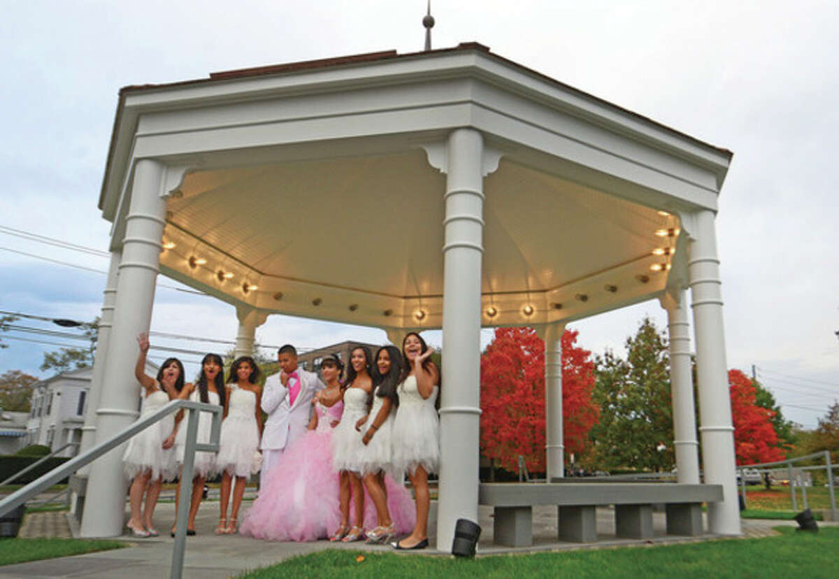 Hour photo / Erik Trautmann The new gazebo on the Norwalk Town Green hotsed a Quinceañera for Alexa Rosario who celebrated with a photo shoot at the new structure rebuilt by the First Taxing District recently.