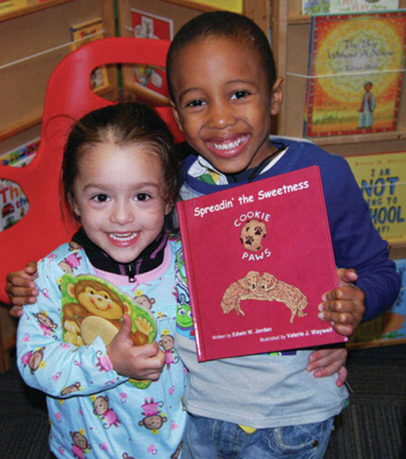 Contributed photosChildren are all smiles after receiving new books and pajamas through the efforts of the Connecticut chapter of Pajama Program.
