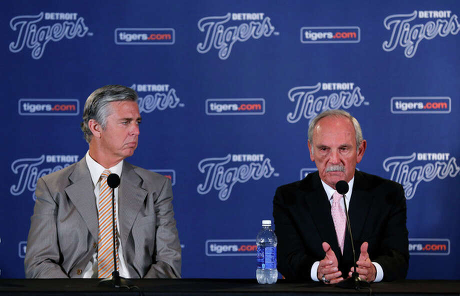 Detroit Tigers baseball manager Jim Leyland, right, announces his retirement as general manager David Dombrowski, left, listens during a news conference at Comerica Park in Detroit, Monday, Oct. 21, 2013. (AP Photo/Paul Sancya) / AP