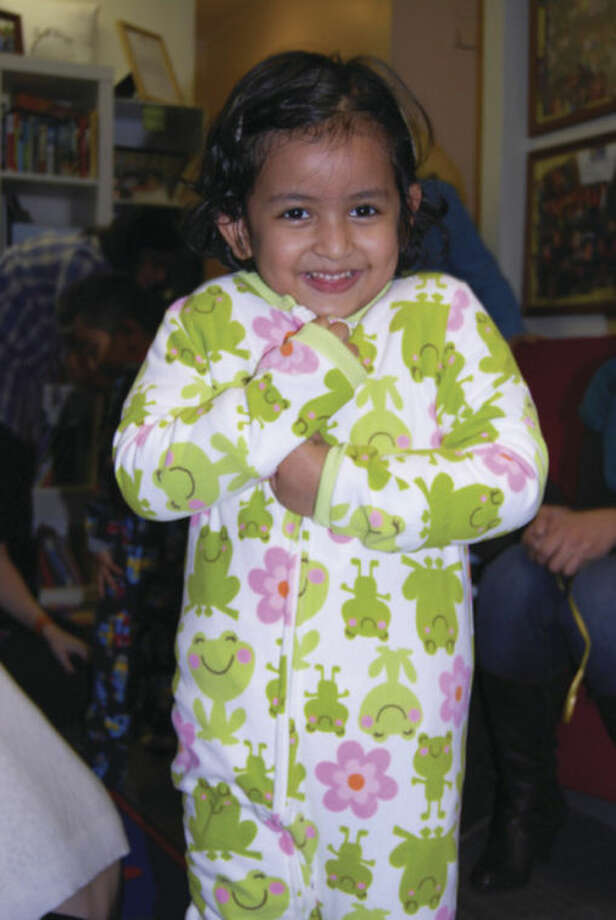 Children receive new books and pajamas thanks to Connecticut chapter of Pajama Program.