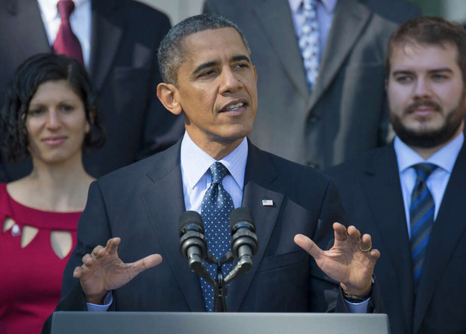 President Barack Obama gestures while speaking in the Rose Garden of the White House in Washington, Monday, Oct. 21, 2013, on the initial rollout of the health care overhaul. Obama acknowledged that the widespread problems with his health care law's rollout are unacceptable, as the administration scrambles to fix the cascade of computer issues. (AP Photo/ Evan Vucci) / AP