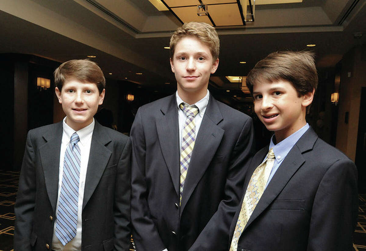 Hour photo/Matthew Vinci Three members of the Westport team that went to the Little League World Series, from left, Drew Rogers, Harry Azadian and Alex Reiner, chat at the Fairfield County Sports Commision SportsNight Monday at the Greenwich Hyatt Regency. The Little League team was selected as Sportsmen of the year for their hometown.